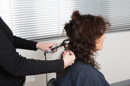 indoor shot: Woman at hairdresser, indoor shot Stock Photo