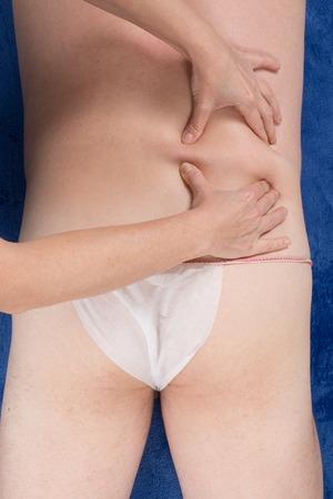 healing process: healing process - male receiving back massage - close up