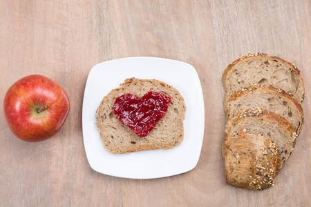 marmelade: Breakfast with bread marmelade in shape of heart  and coffee Stock Photo