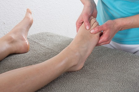 beauty center: Massage of human foot in spa salon at beauty center Stock Photo