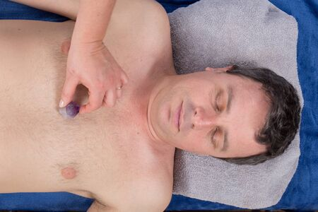 chakra energy: Alternative medicine, therapist using gemstones, amethyst,  for lithotherapy