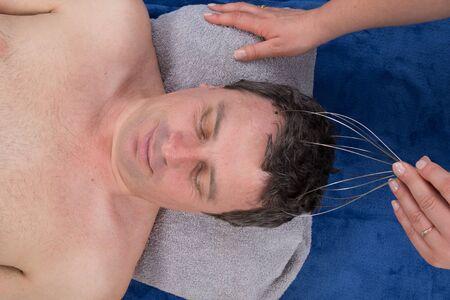 shiatsu: Chakras head massage shiatsu isolated on white Stock Photo