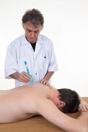 moxa: Alternative medicine therapist doing moxa treatment on his client Stock Photo