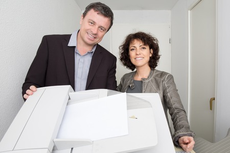 copy machine: Two product designers, standing behind a copy machine Stock Photo