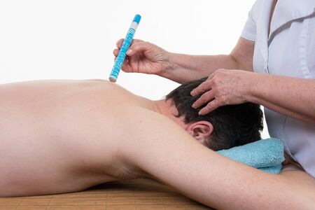 moxa: An alternative eastern Moxa treatment on a mans back