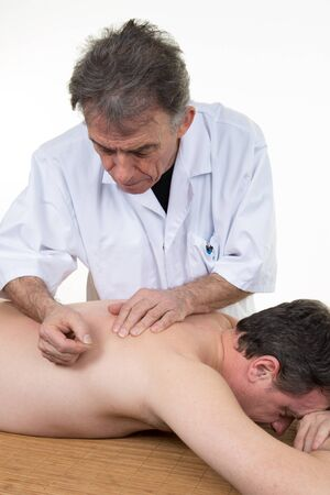 moxibustion: Man therapist who put the moxibustion on the back
