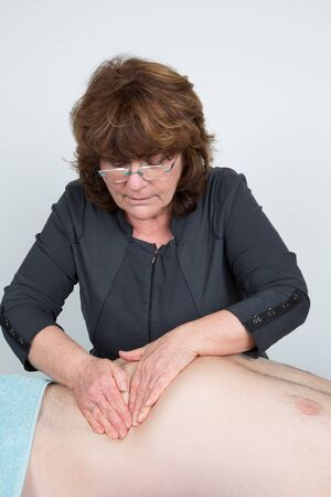 visceral: Macro close up of Osteopathic belly massage. visceral massage
