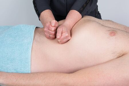 visceral: Man having a visceral massage. Close-up in a spa center Stock Photo