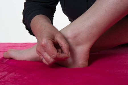 receives: A patient receives a foot acupuncture Stock Photo