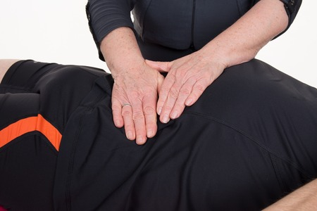 lymphatic drainage: Position of hands and fingers at lymphatic drainage massage of a male body