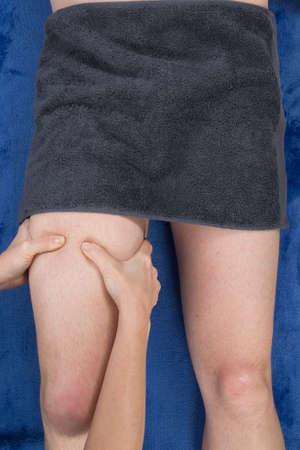hamstrings: Close up of therapist applying pressure on female hamstrings