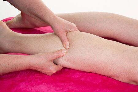 female therapist: A picture of a physio therapist giving a knee massage Stock Photo