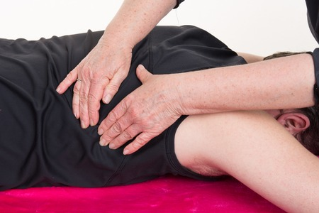 medical therapy: Patient at the physiotherapy gets massage or lymphatic drainage Stock Photo