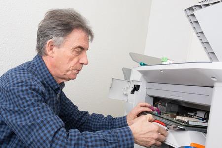 photocopier: Closeup shot of technician fixing photocopier machine Stock Photo