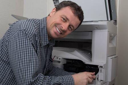 toner: Man repairing color printer changing toner cartridge Stock Photo