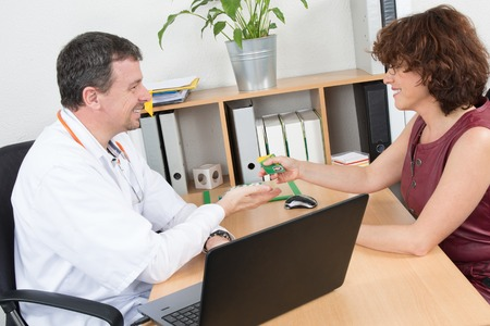 sales rep: Happy medical rep in a meeting with a cheerful doctor Stock Photo
