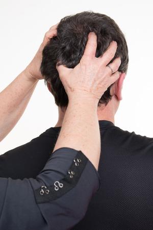 hair dryer: Hairdresser male  doing head massage to customer at beauty center