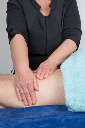 lymphatic drainage: Woman physical therapist at work in her office Stock Photo
