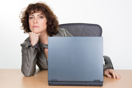 35 to 40 years old: Middle-aged woman working at work on laptop