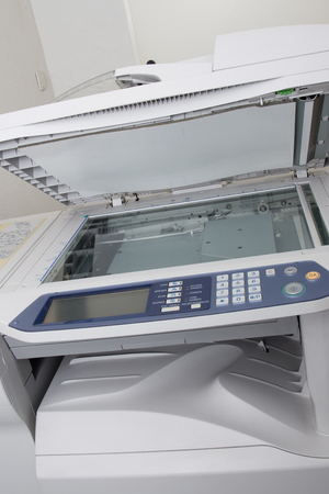 Front view of the office photocopier with numeric pad and electronic display, isolated on white 版權商用圖片