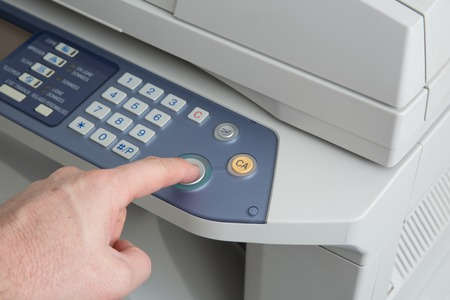midsection: Midsection of businessman operating printer in office