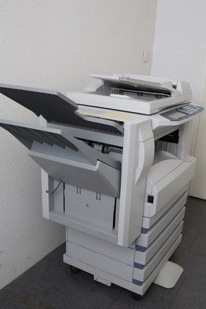 numpad: Modern photocopier with a digital display isolated at office