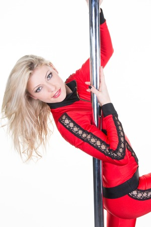 insides: Young sexy pole dance woman isolated