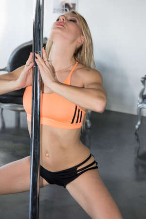 pole dancing: pole dancing and gymnastic course. concept about wellness and sport Stock Photo