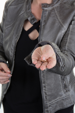 variance: Woman returned wedding ring to her husband . Divorce concept