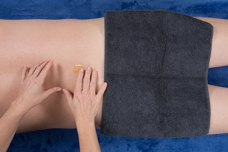massaged: Laid man being massaged by a female hands therapist Stock Photo