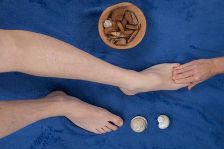 masseuse: Close up of female masseuse massaging mans foot Stock Photo