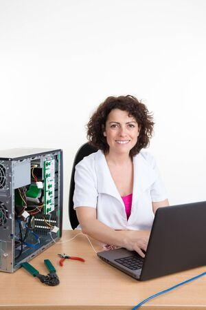 technically: Woman repairing an electronic component of a computer