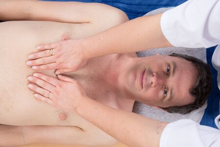 lymphatic drainage therapy: Man having a massage in a wellness center