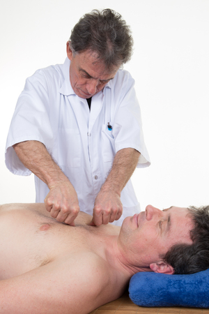 holistic care: Bowen therapy - massage treatment of the back of man