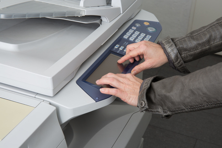 copy machine: Womans hand with working copy machine at office, good job Stock Photo