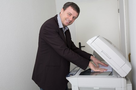 photocopy: Businessman who makes a photocopy at business place