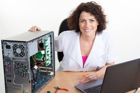 person on computer: Young scientist repairs electronic device in modern laboratory Stock Photo