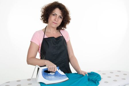 ironing board: Close-up Of Maid Ironing Clothes On Ironing Board Stock Photo