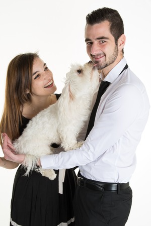 handsome men: Lovely attractive couple and dog together, studio shot, white background