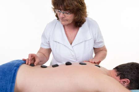 alternativ: Stone treatment. man getting a hot stone massage at a day spa
