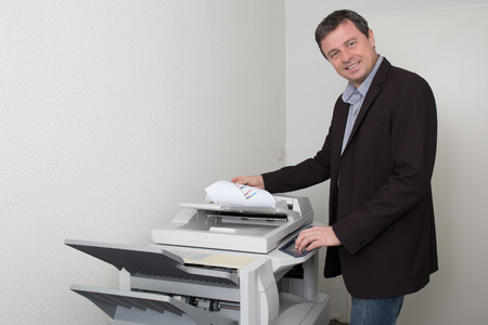 photocopy: Businessman who makes a photocopy at work
