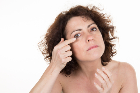 40 year old woman: Middle-aged woman applying anti-aging cream