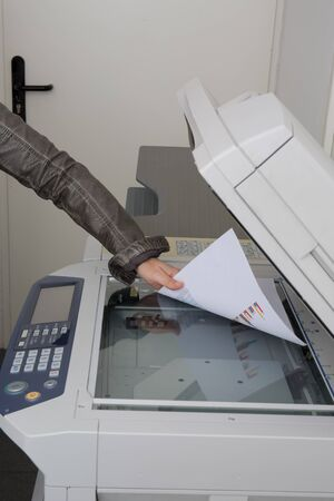 photocopy: young businesswoman using  photocopy machine in office