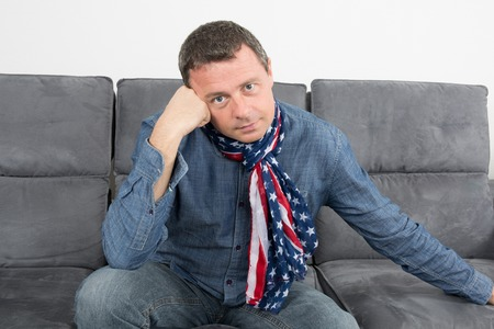 scarf: Closeup portrait of trendy guy wearing scarf, looking at camera. Stock Photo