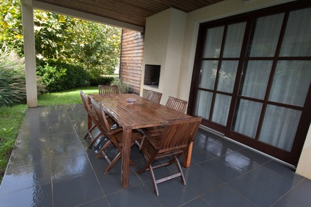 hardwood flooring: Stylish wooden outdoor terrace with seating arrangement with dark grey stained hardwood flooring