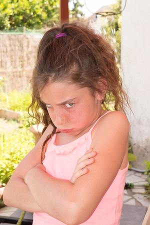 conflicted: Unhappy girl expressing disagreement with a body language