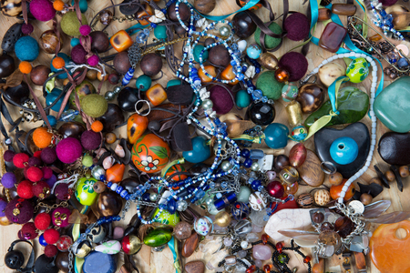 jumbled: Collection of assorted gemstone jewellery with pearls, necklaces, rings, bracelets and chains in a jumbled pile for a fashion background Stock Photo