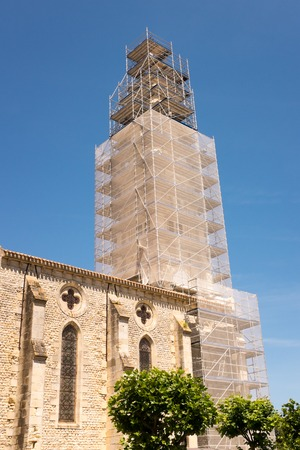 Restoration of an old gothic church under blue sky