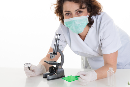 biochemist: Closeup of a female scientist filling test tubes with pipette in laboratory.
