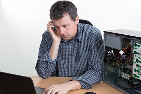 no idea: Man with no idea how to repair his computer Stock Photo